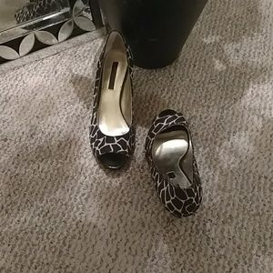 Giraffe inspired heels with peep toe. Gently used.